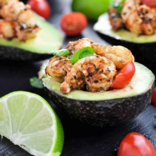 Close up view of Cajun Shrimp Stuffed Avocados with lime