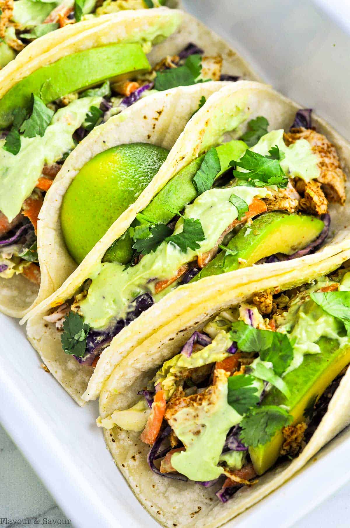 Close up view of Shredded Chicken Tacos with Cilantro Lime Slaw