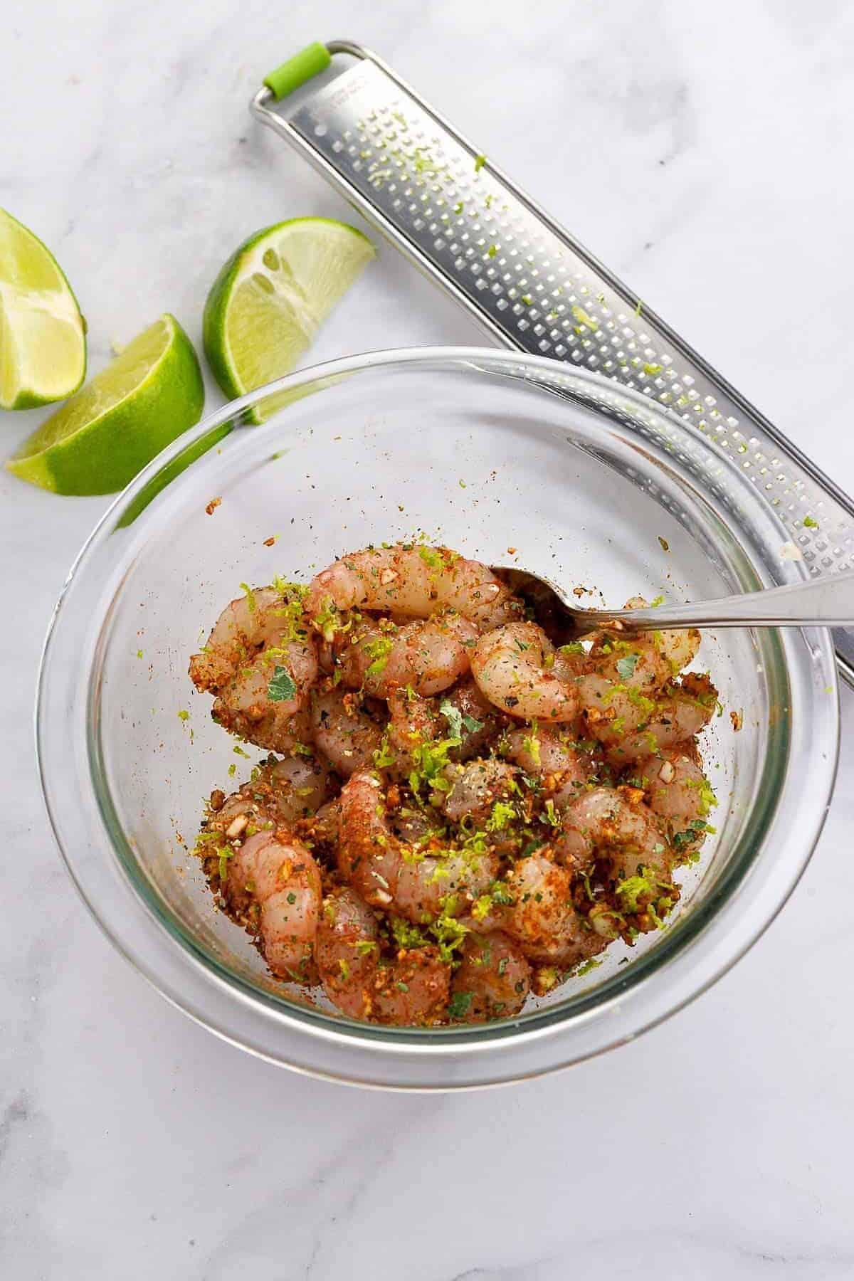 Tossing prawns or shrimp with Cajun spices for Shrimp Stuffed Avocado boats
