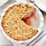 Strawberry Rhubarb Crumble Pie with one slice removed