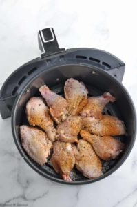 Uncooked Chicken Wings in a Ninja air fryer basket
