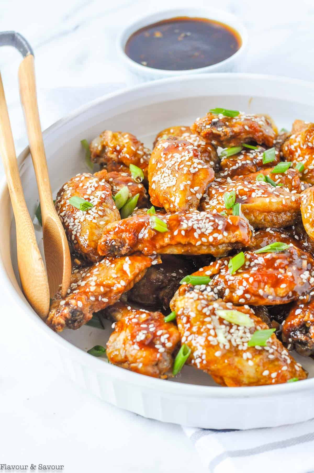 Air Fryer Teriyaki Chicken Wings with dipping sauce and tongs