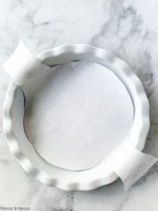 A round cake pan lined with parchment paper