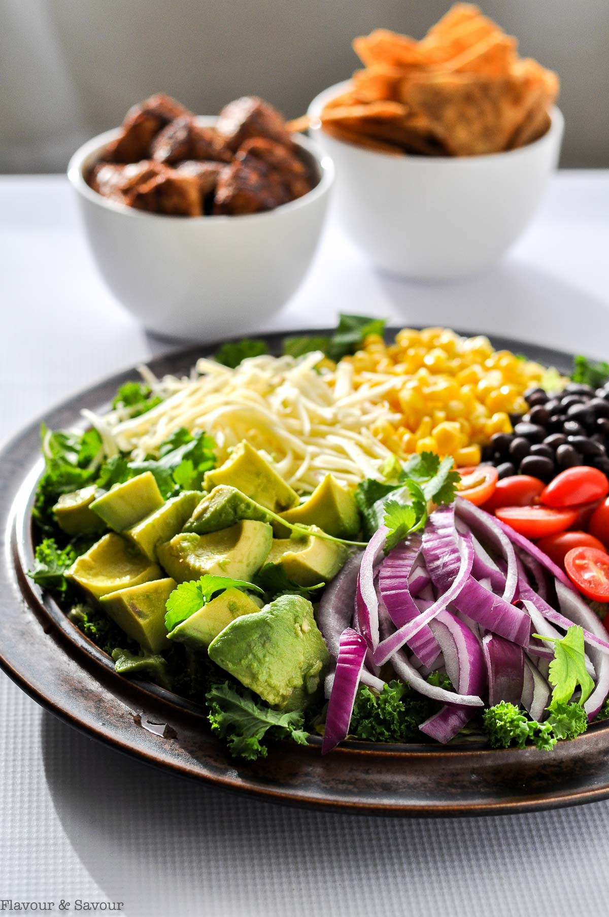 Side view of ingredients on a large platter for Chicken Taco Salad