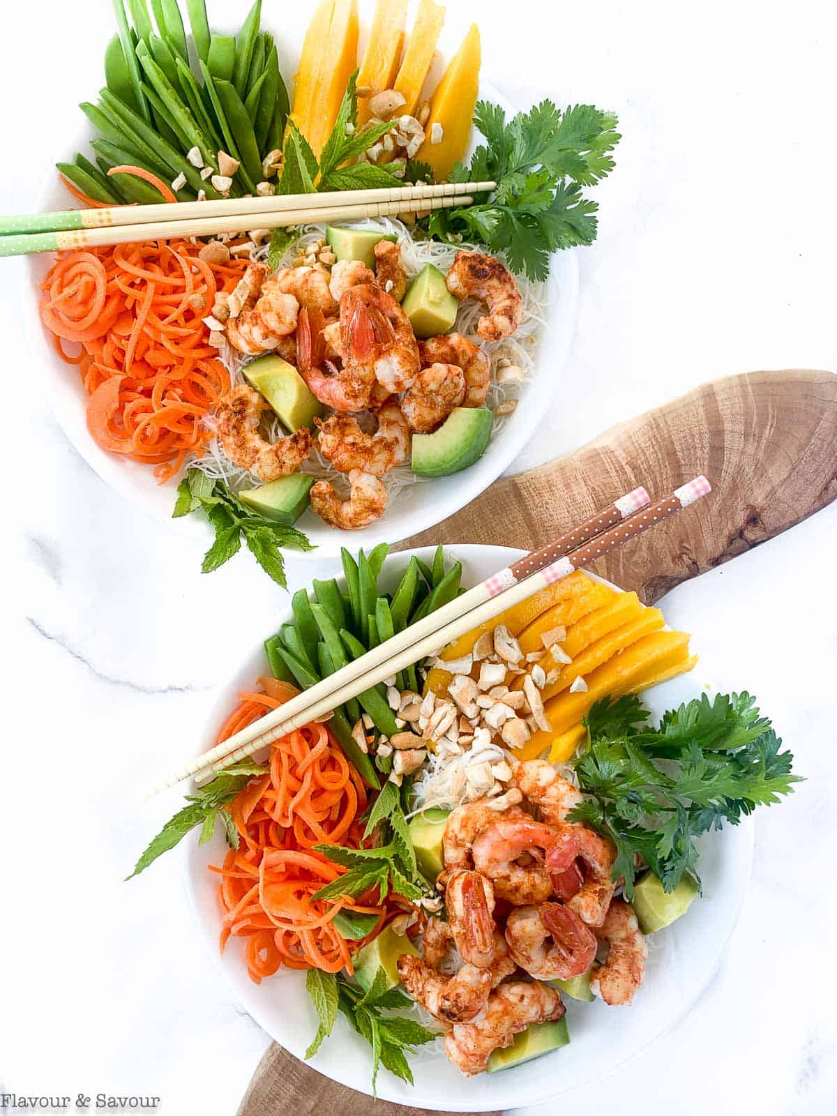 Two Vietnamese Prawn (Shrimp) Noodle Bowls on a board with chopsticks