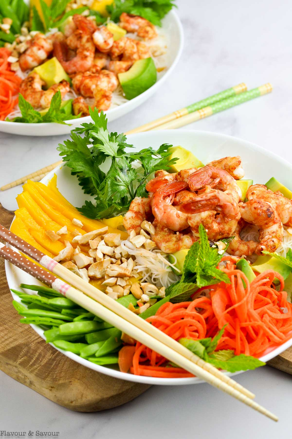 Two bowls of Vietnamese Prawn Noodle Bowls with chopsticks
