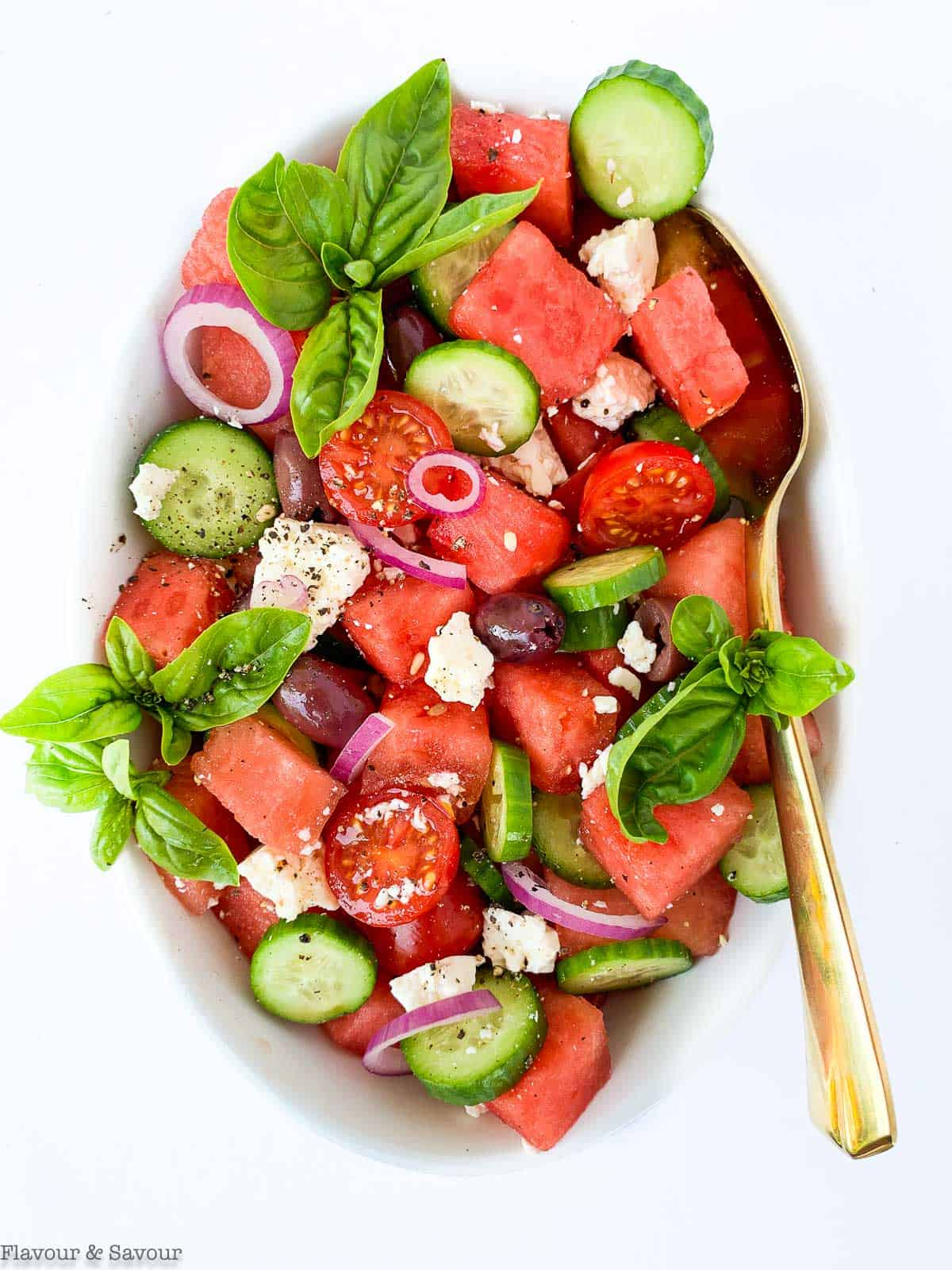 Greek Watermelon Basil Salad overhead view with a gold spoon