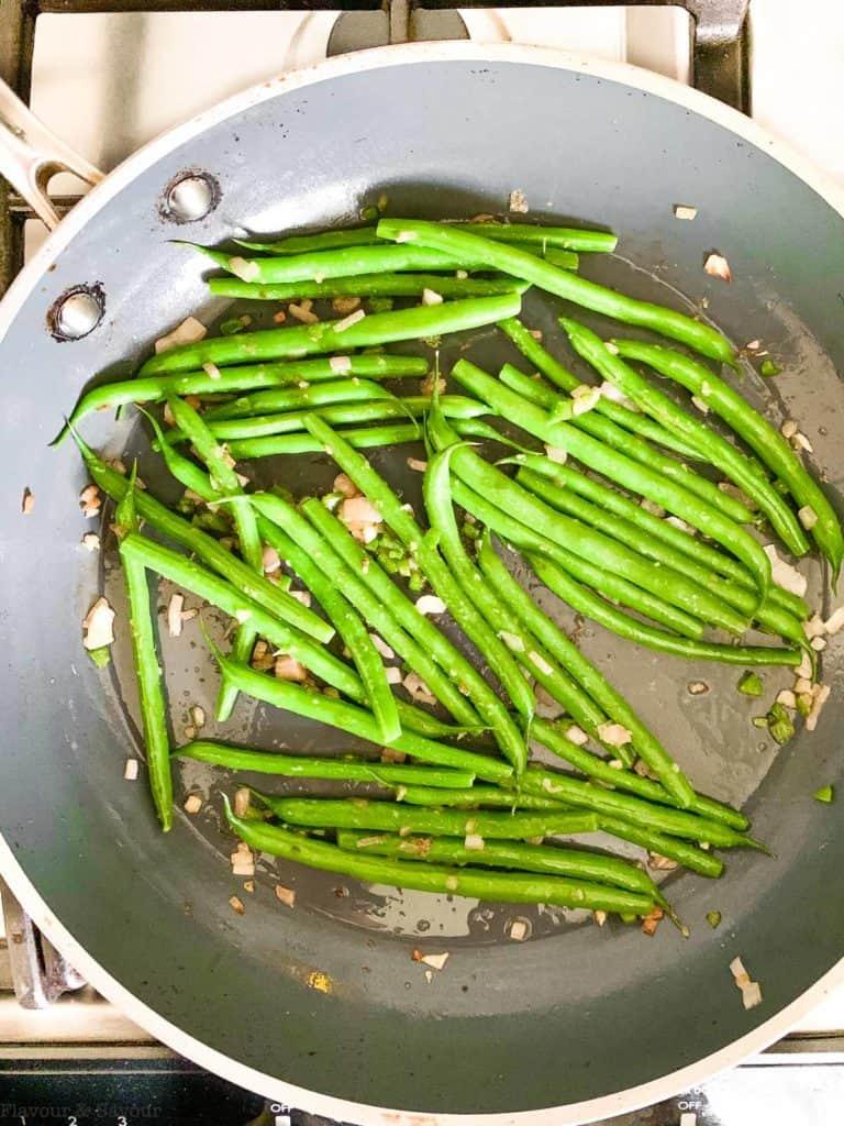 Sautéing green beans in a skillet