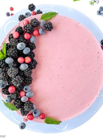 Blackberry Cheesecake Ice Cream Cake decorated with blackberries and blueberries