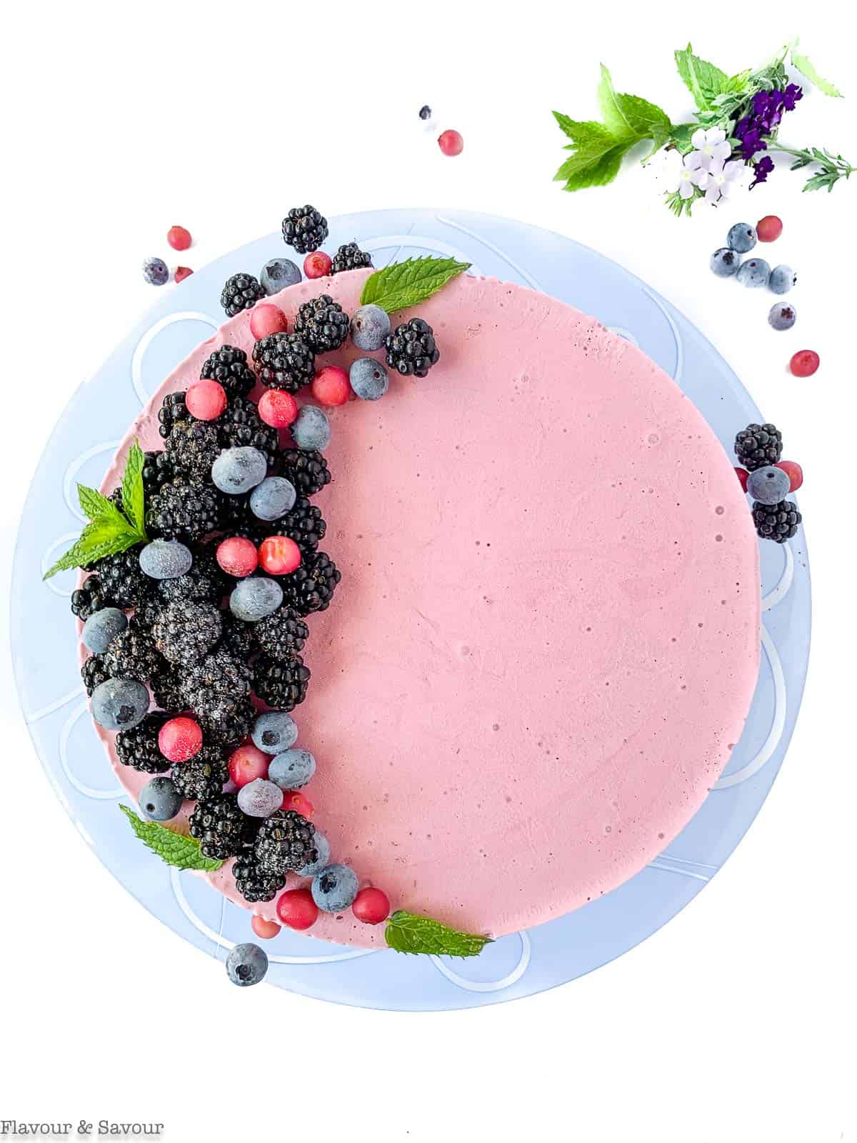 Overhead view of Blackberry Ice Cream Cheesecake decorated with blackberries and blueberries