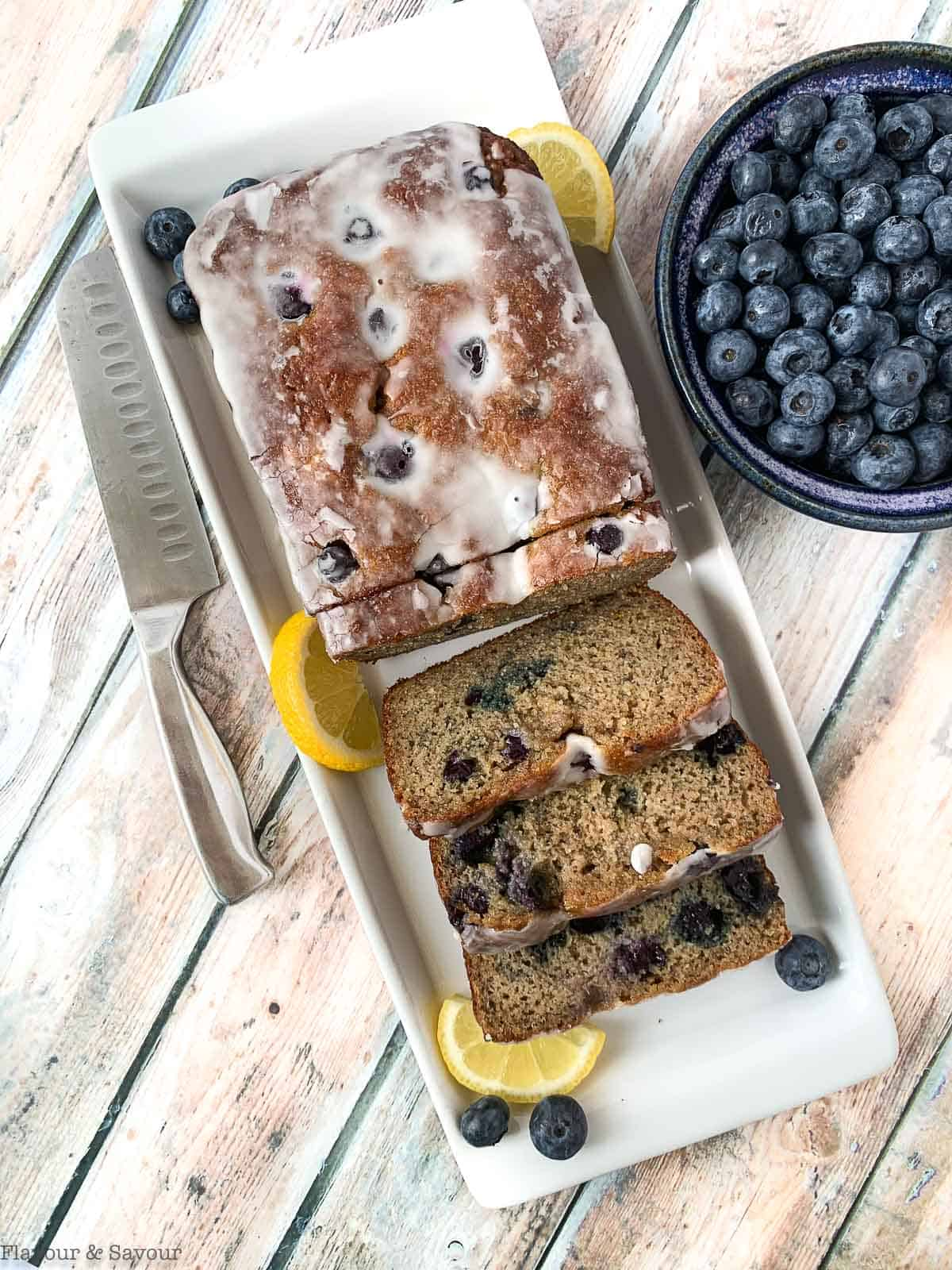 Grain Free Blueberry Banana Bread with a bowl of blueberries