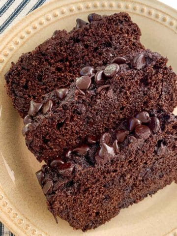 Three slices of double chocolate zucchini bread with chocolate chip topping