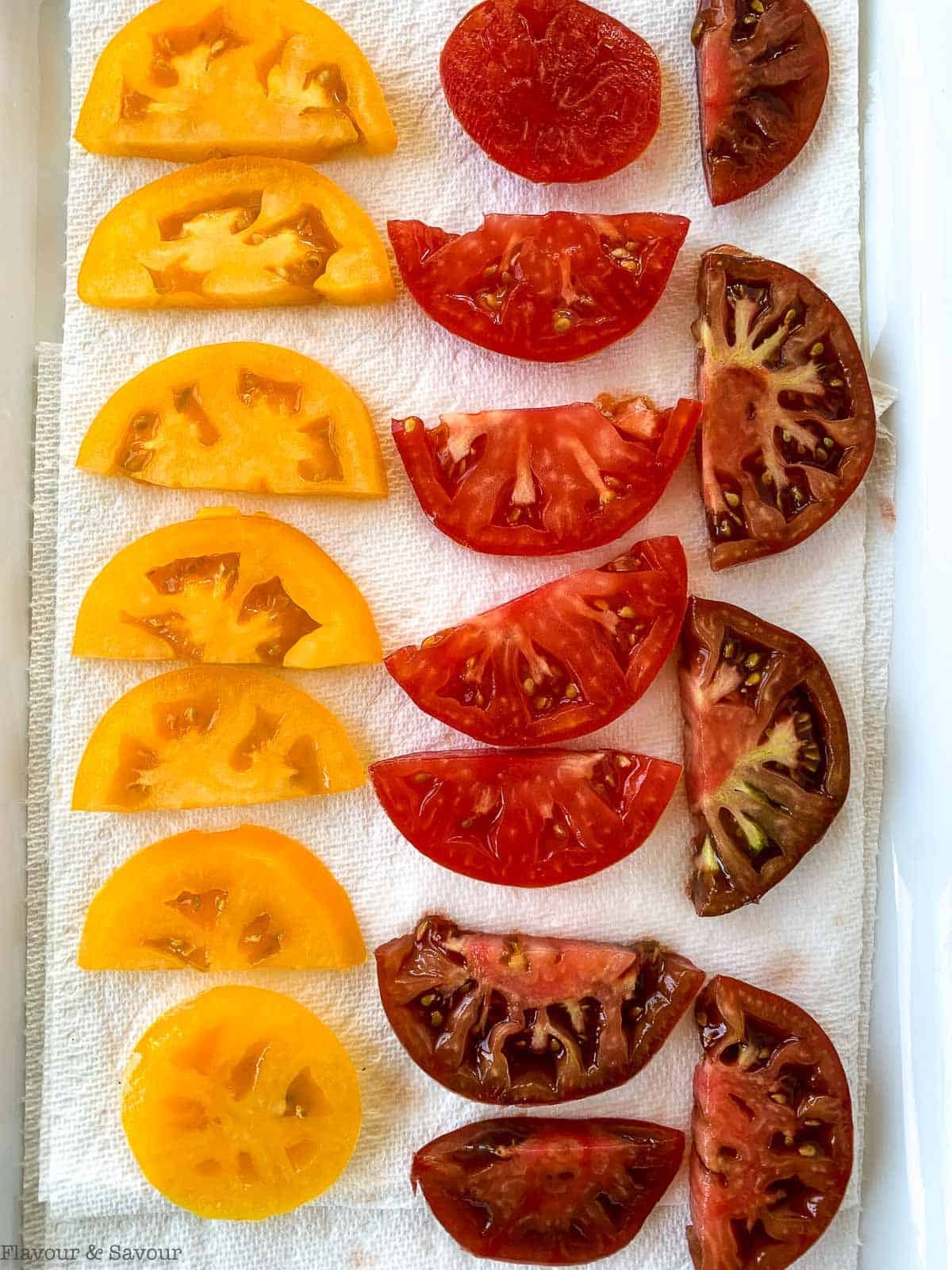 Draining tomatoes on paper towel