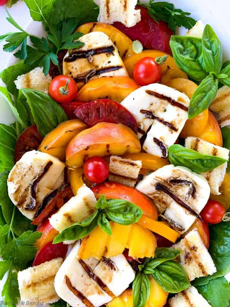 Close up view of Grilled Halloumi Peach and Tomato Salad with croutons