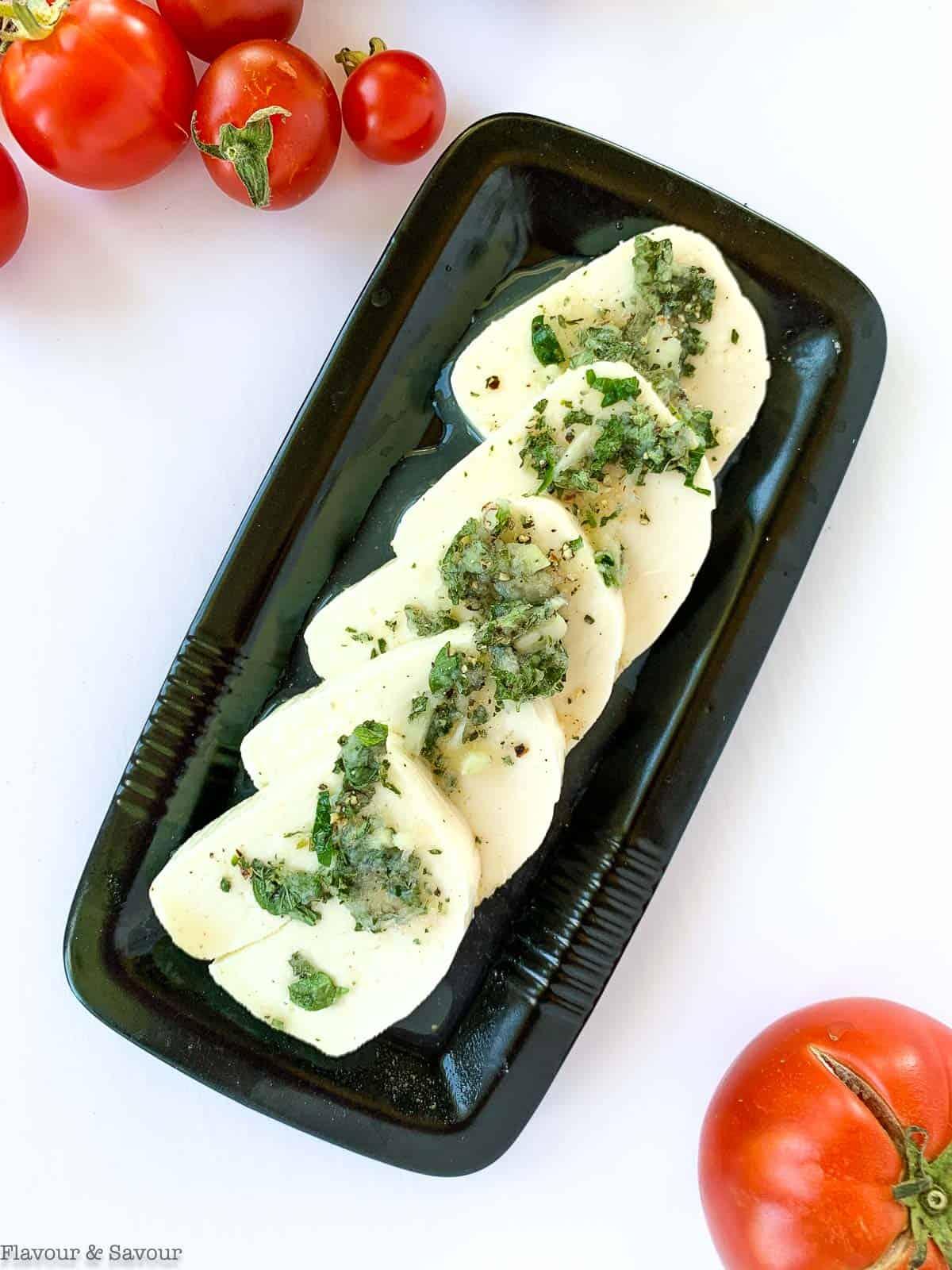 Marinating halloumi cheese with oregano garlic and lemon juice