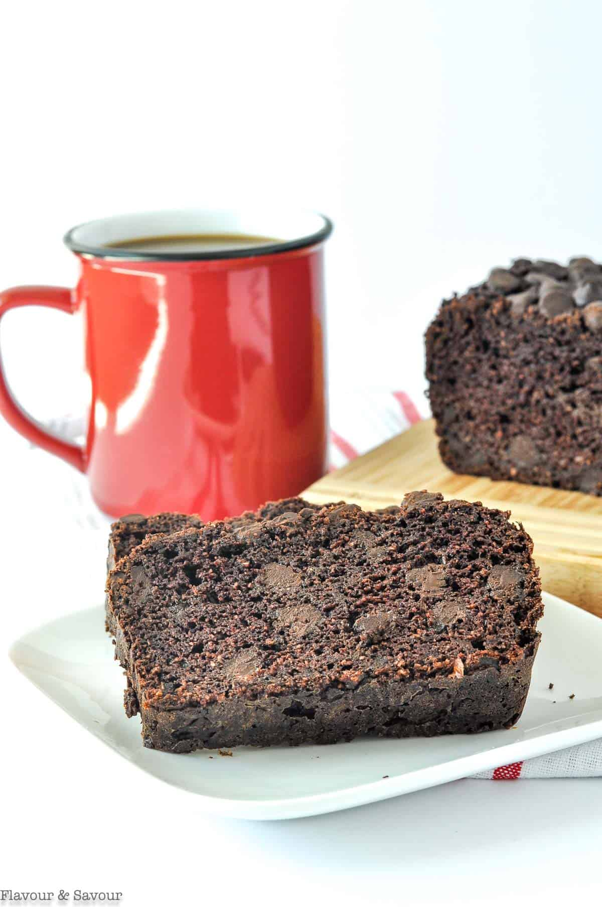 Sliced Grain-Free Double Chocolate Zucchini Bread with a mug of coffee