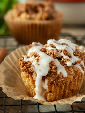 Close up view of a Vanilla Glazed Apple Muffin with Maple Cinnamon Streusel