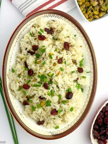 A bowl of Cranberry Pistachio Jasmine Rice with chives