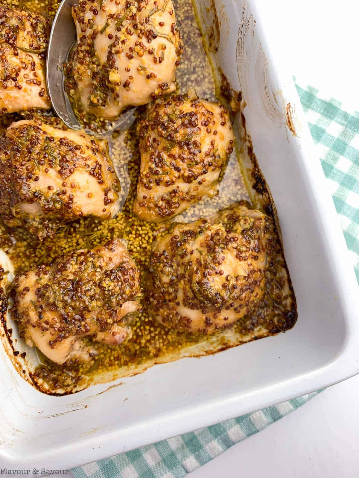 Maple Dijon Chicken Thighs baked in a casserole dish