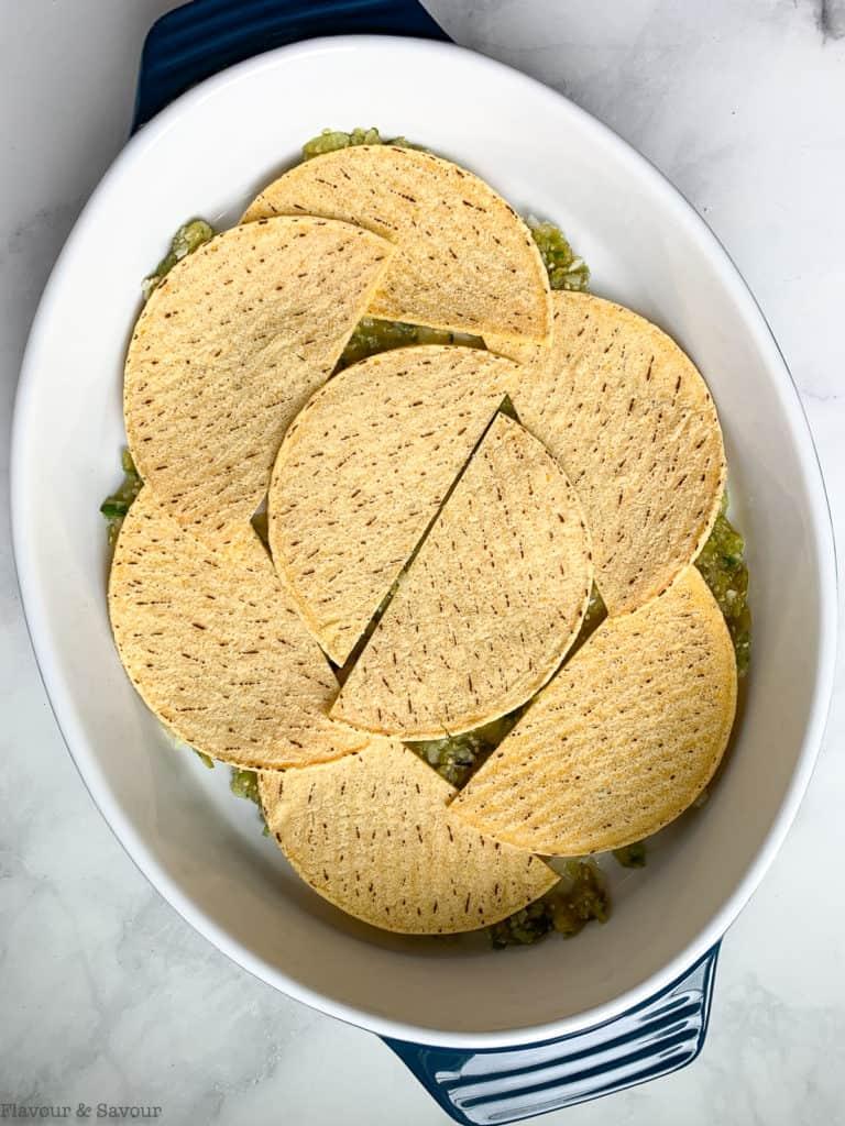 Tortillas are the second layer in salsa verde chicken tortilla bake.