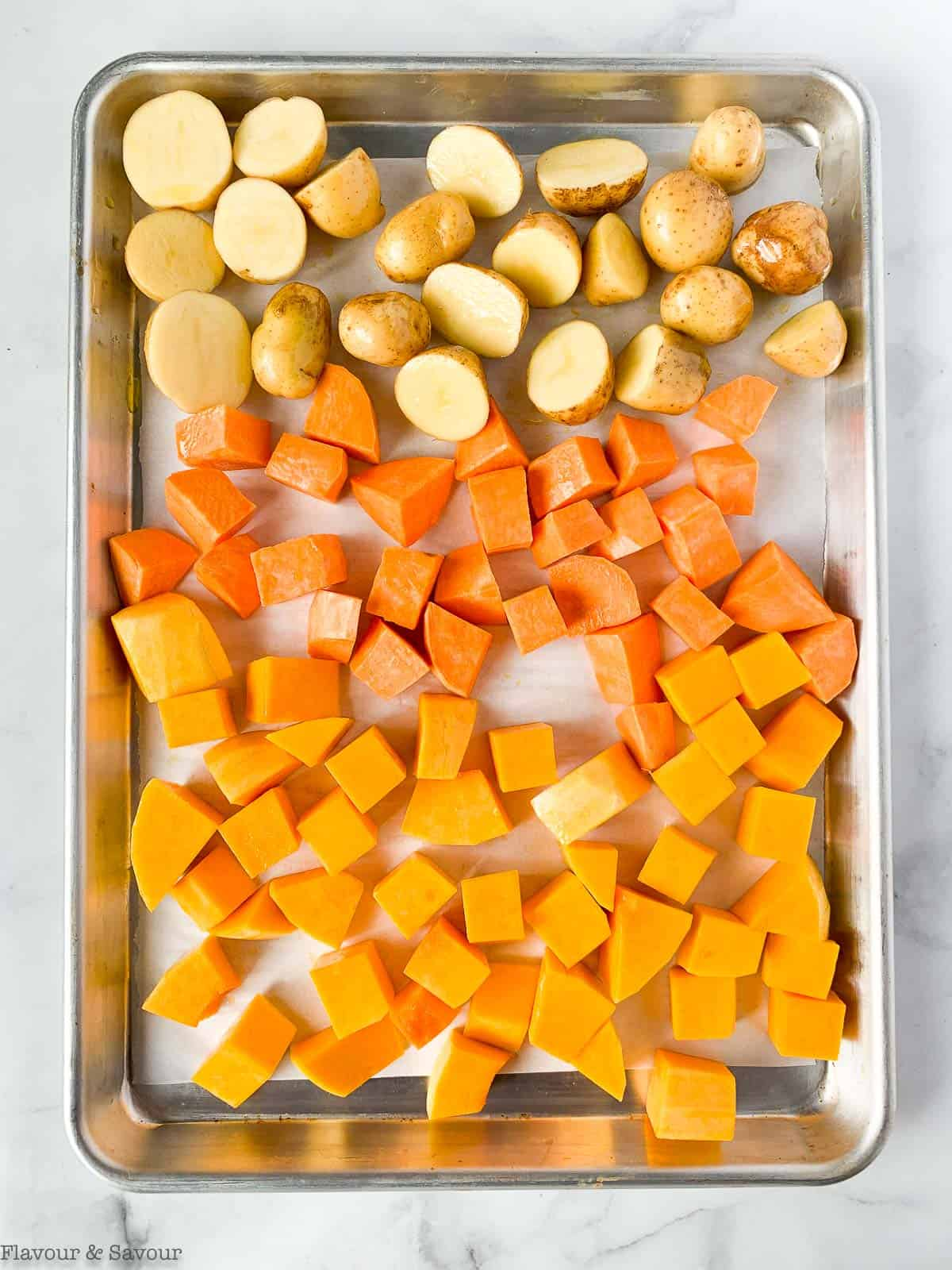 Root vegetables on a baking sheet ready to roast