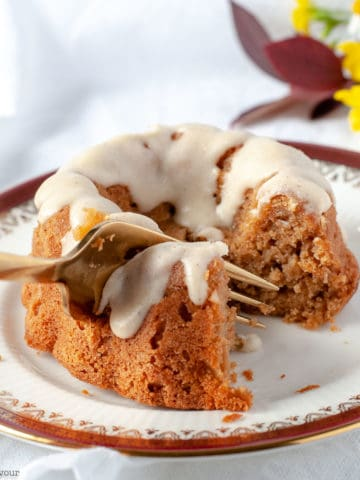 Cutting into a Mini Apple Bundt Cake with a fork