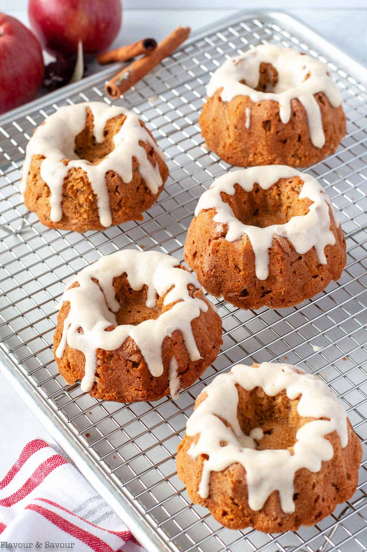 Glazed Mini Apple Bundt cakes on a cooling rack