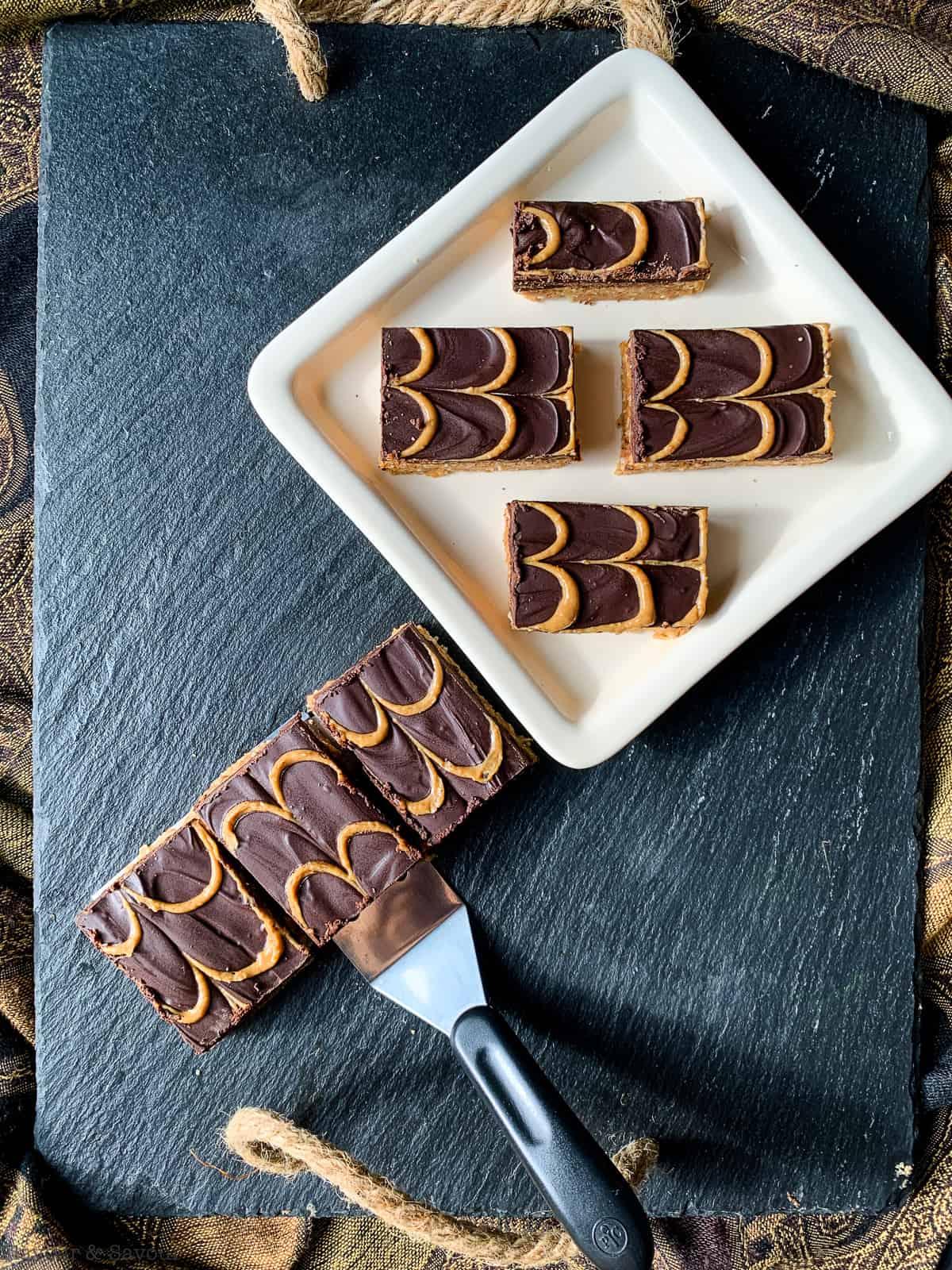Peanut Butter Swirl Chocolate Bars on a black slate serving board