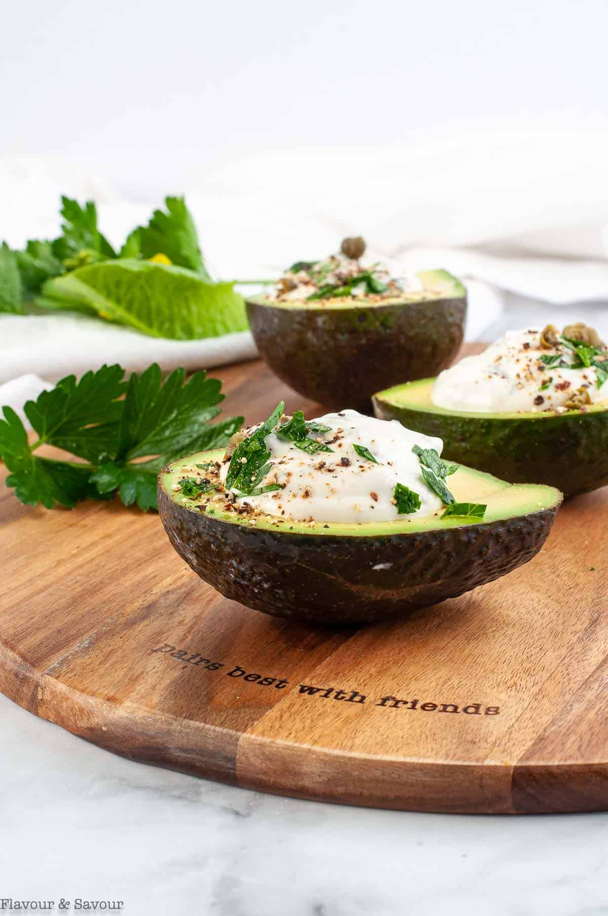 Stuffed Avocados with Creamy Herb Sour Cream Dip side view