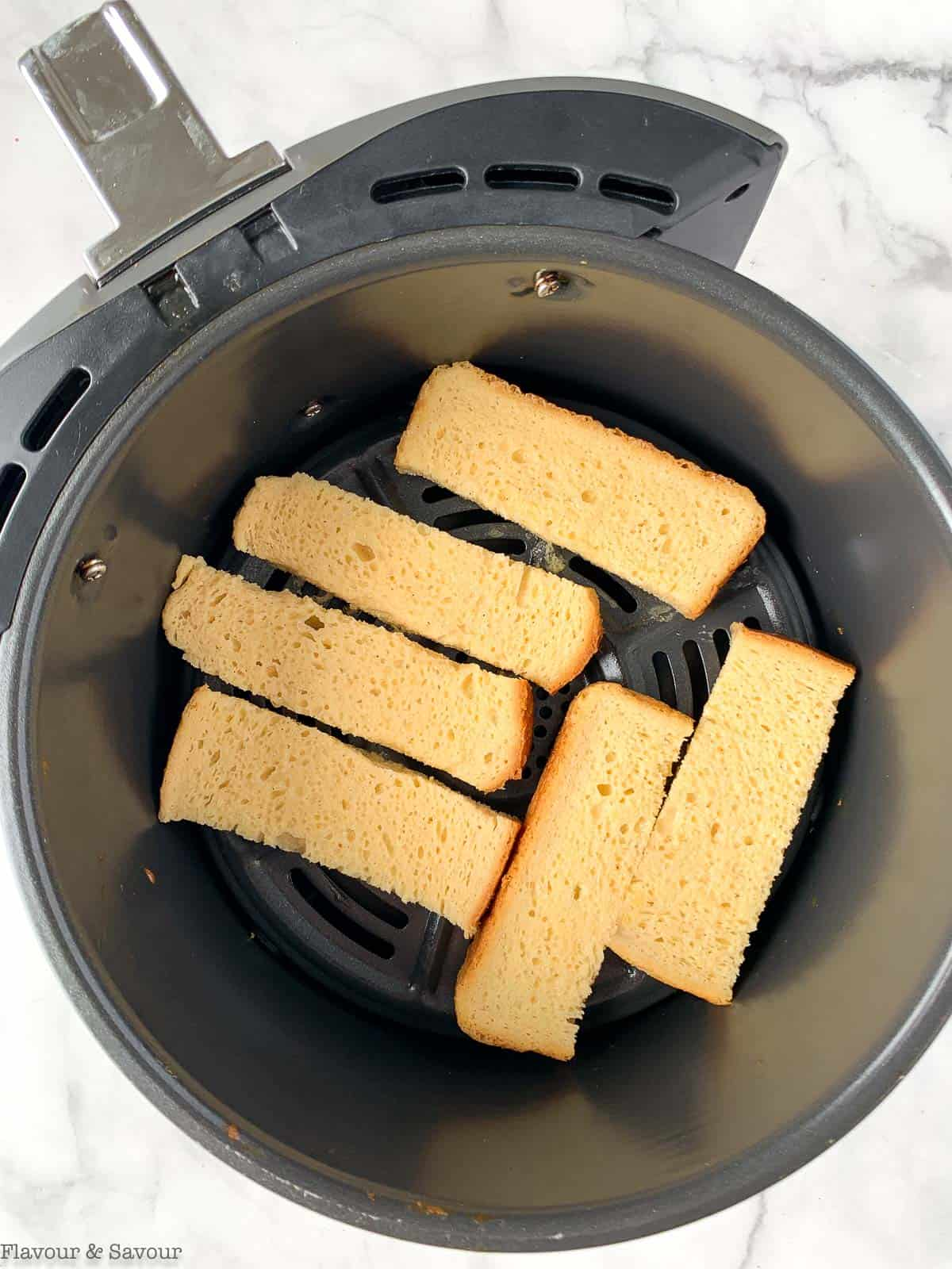 preparing air fried french toast sticks