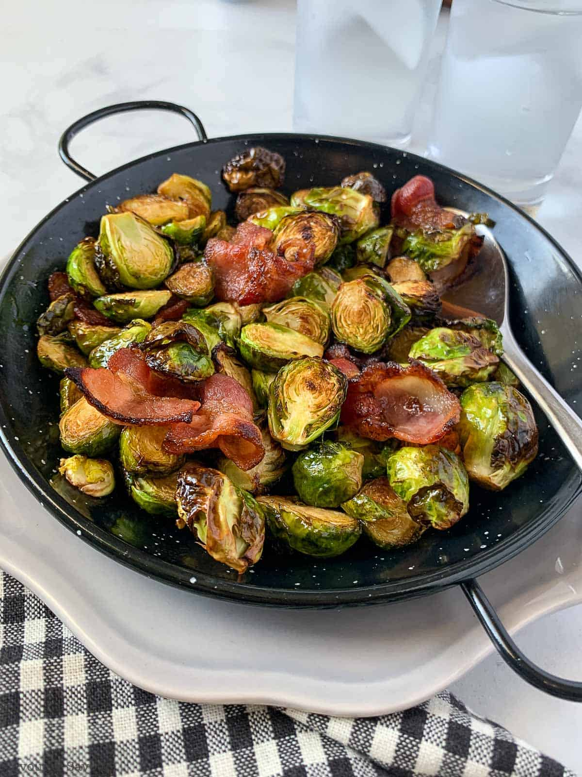 Balsamic Bacon Brussels Sprouts in a black serving dish