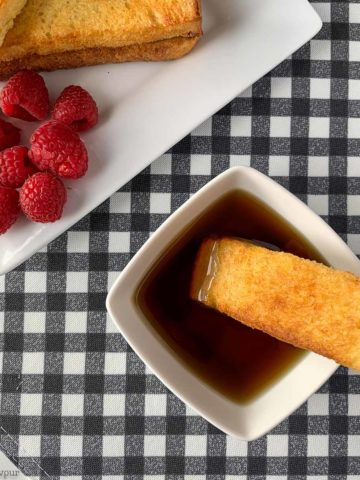 Dipping French Toast Stick in maple syrup