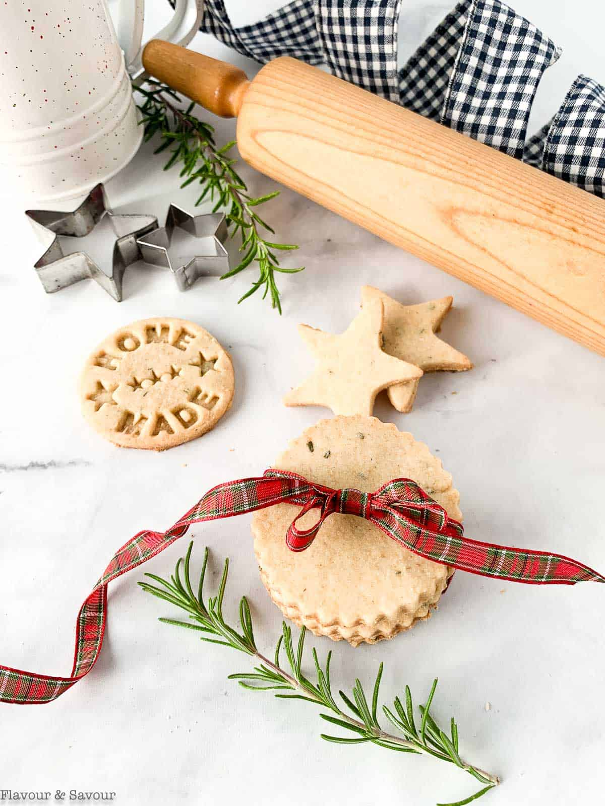 Cookies tied with ribbon with a rolling pin and cookie cutters