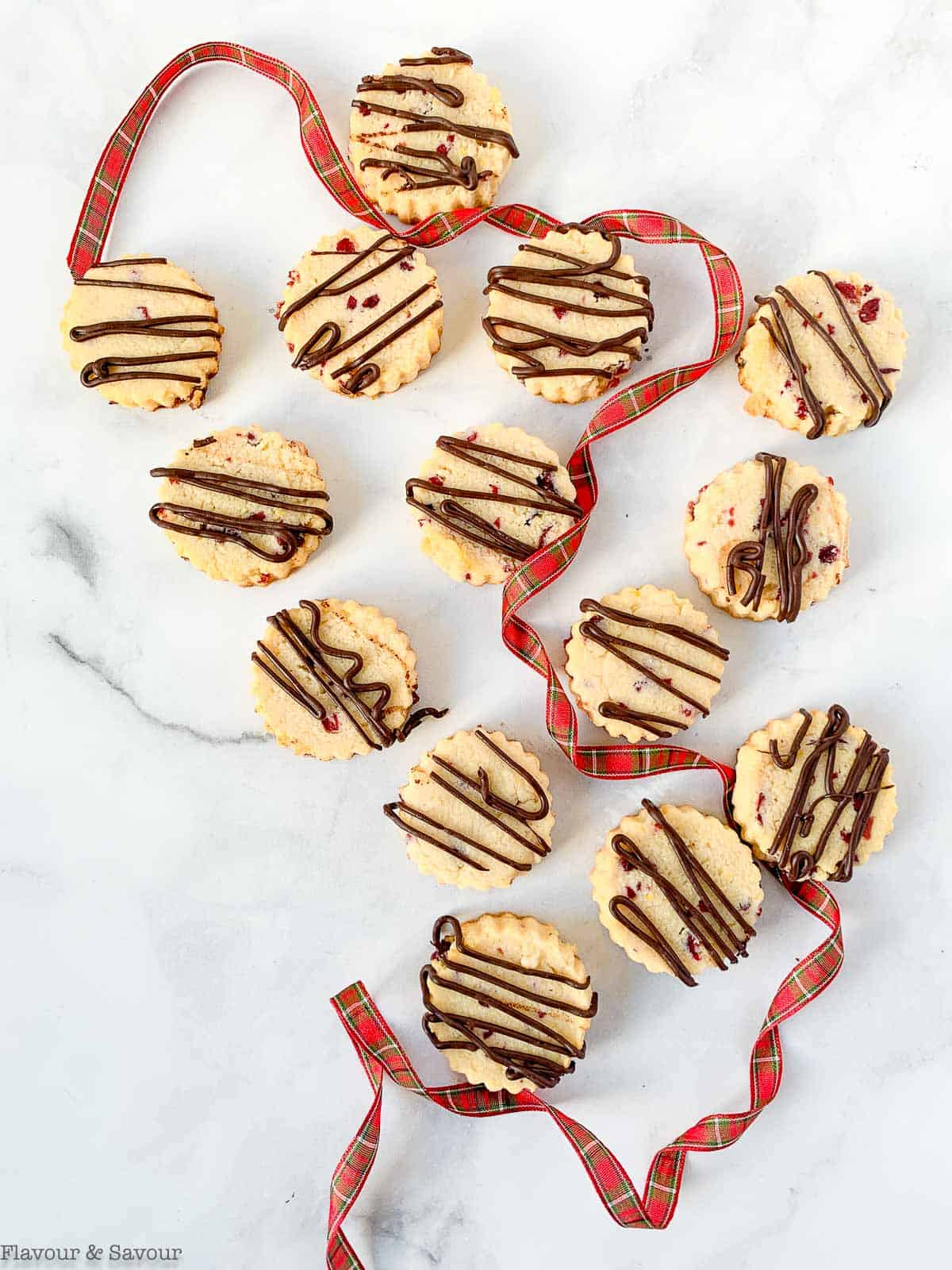 Overhead view of shortbread cookies with plaid ribbon