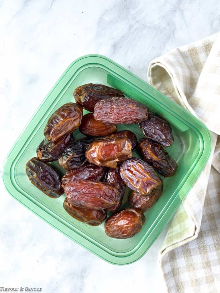 raw Medjool dates in a plastic container