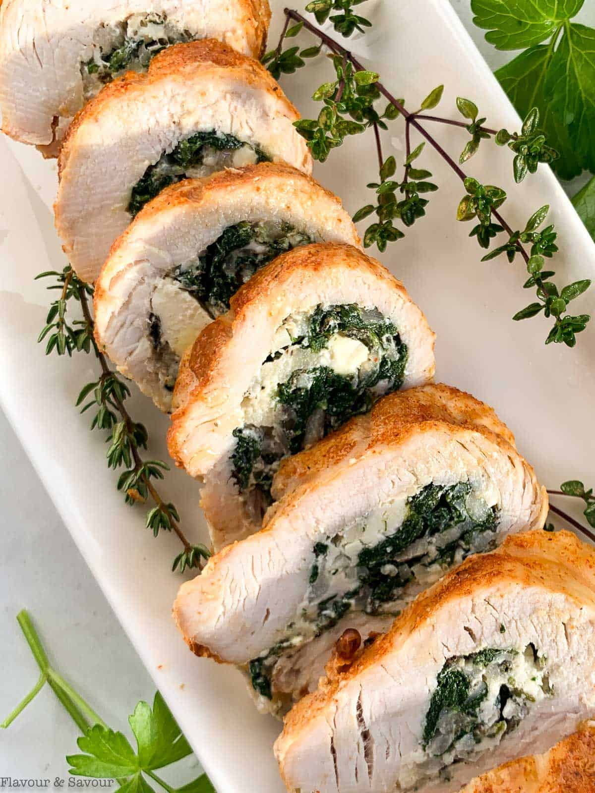 Close up view of slices of stuffed rolled turkey breast