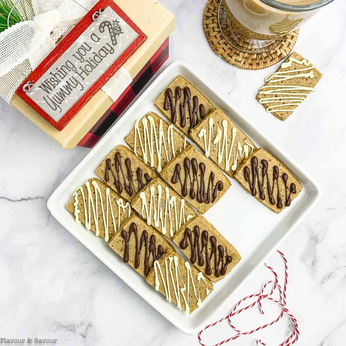 Overhead view of Grain-Free Espresso Almond Flour Shortbread Cookies drizzled with white and dark chocolate