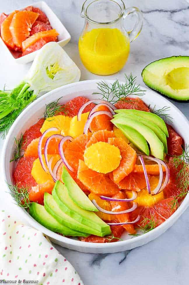 Overhead view of Grapefruit Orange Avocado Salad arranged in layers