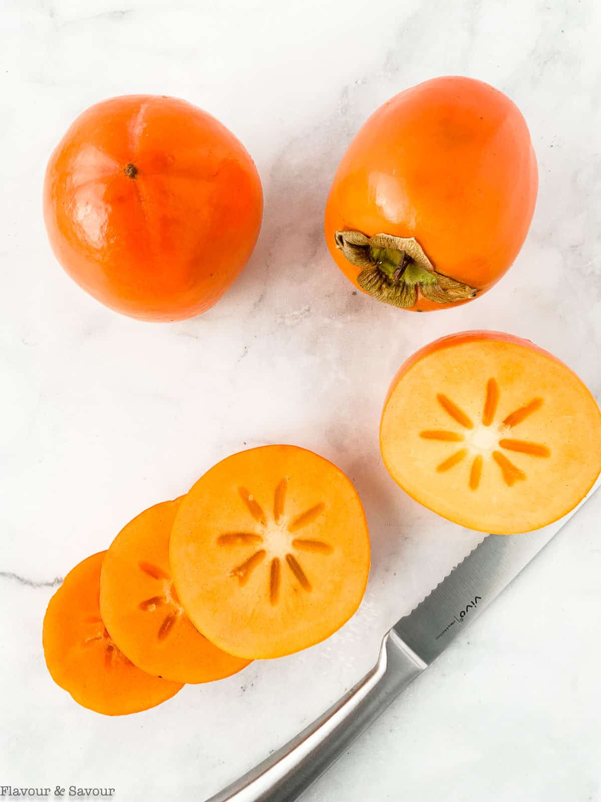 Hachiya persimmons, whole and sliced