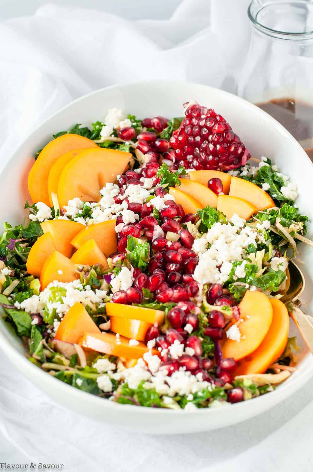 Winter Persimmon Kale Salad with pomegranate and feta