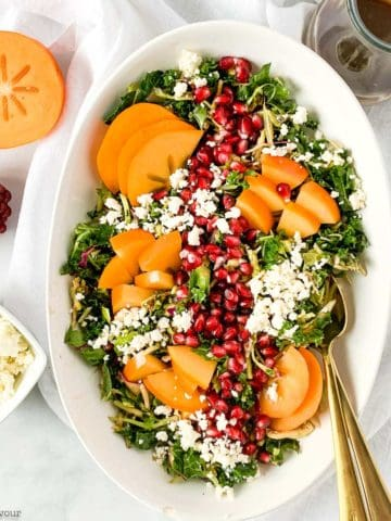 Winter Persimmon Kale Salad with Pomegranate overhead view