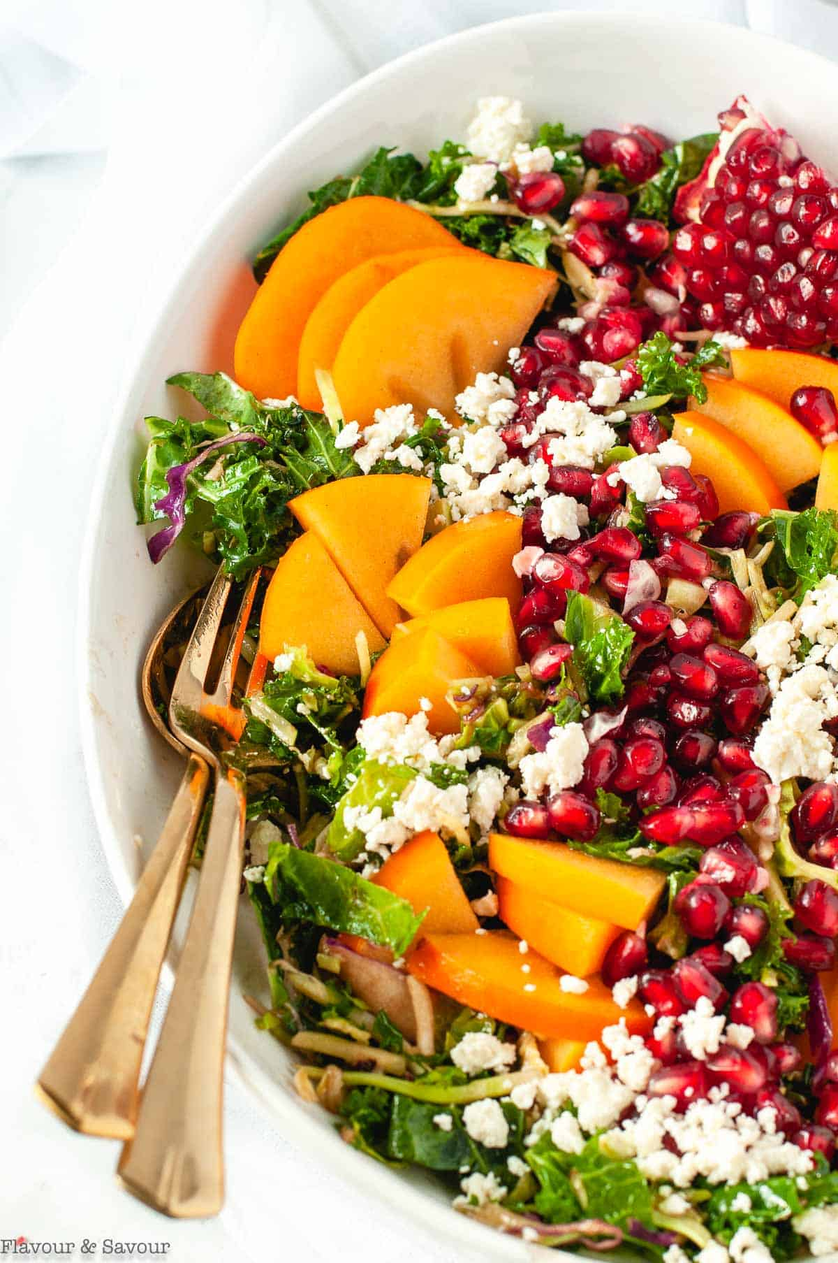 close up view of Winter Pomegranate Persimmon Kale Salad