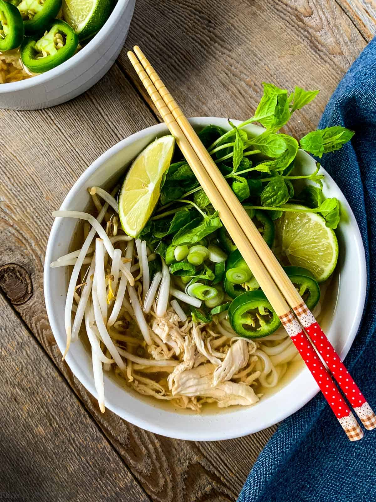 A bowl of Instant Pot Chicken Pho (Pho Ga) with chopsticks