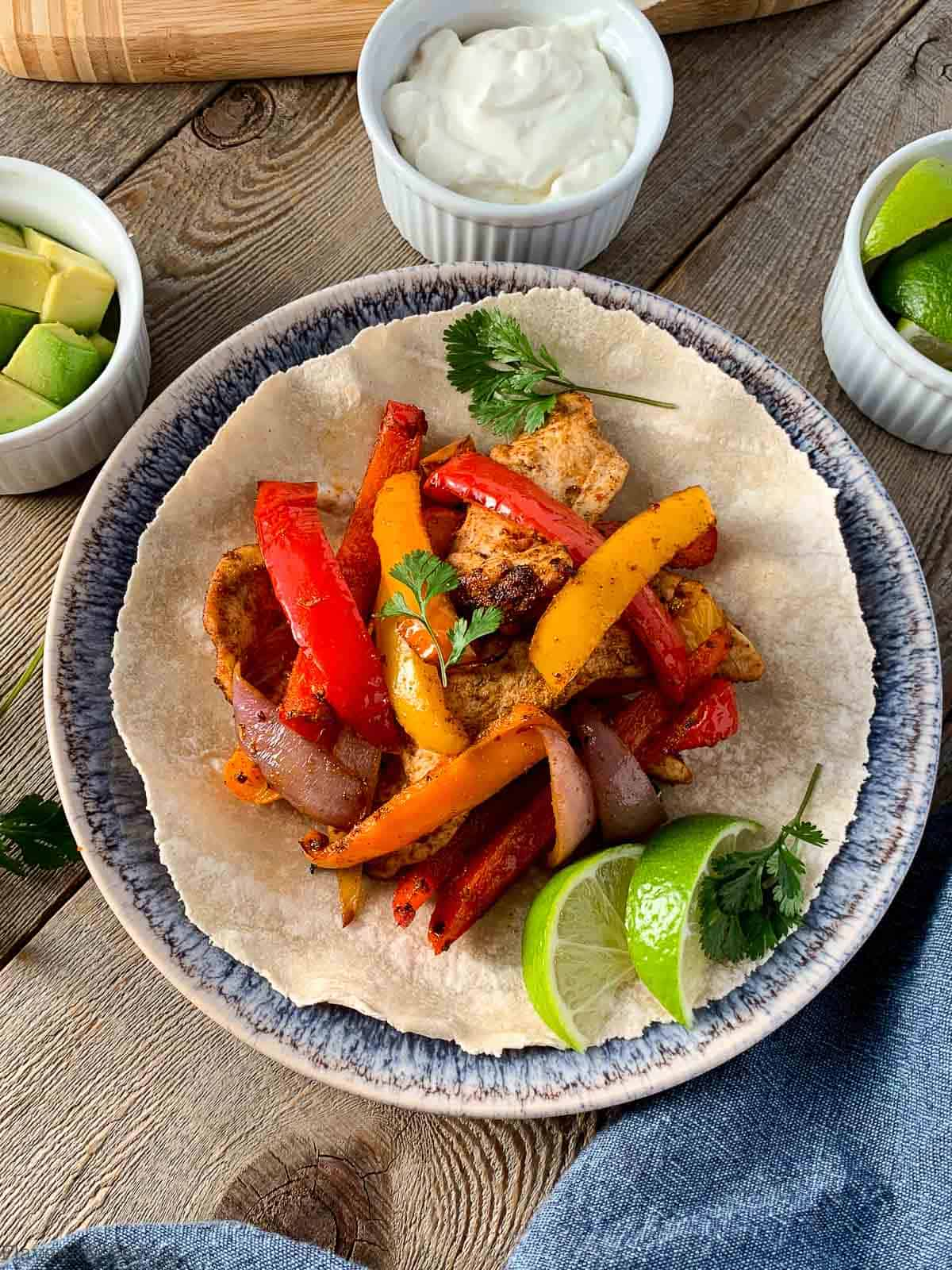 overhead view of air fryer chicken fajitas ready to eat