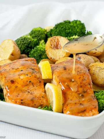 Drizzling glaze on salmon fillets