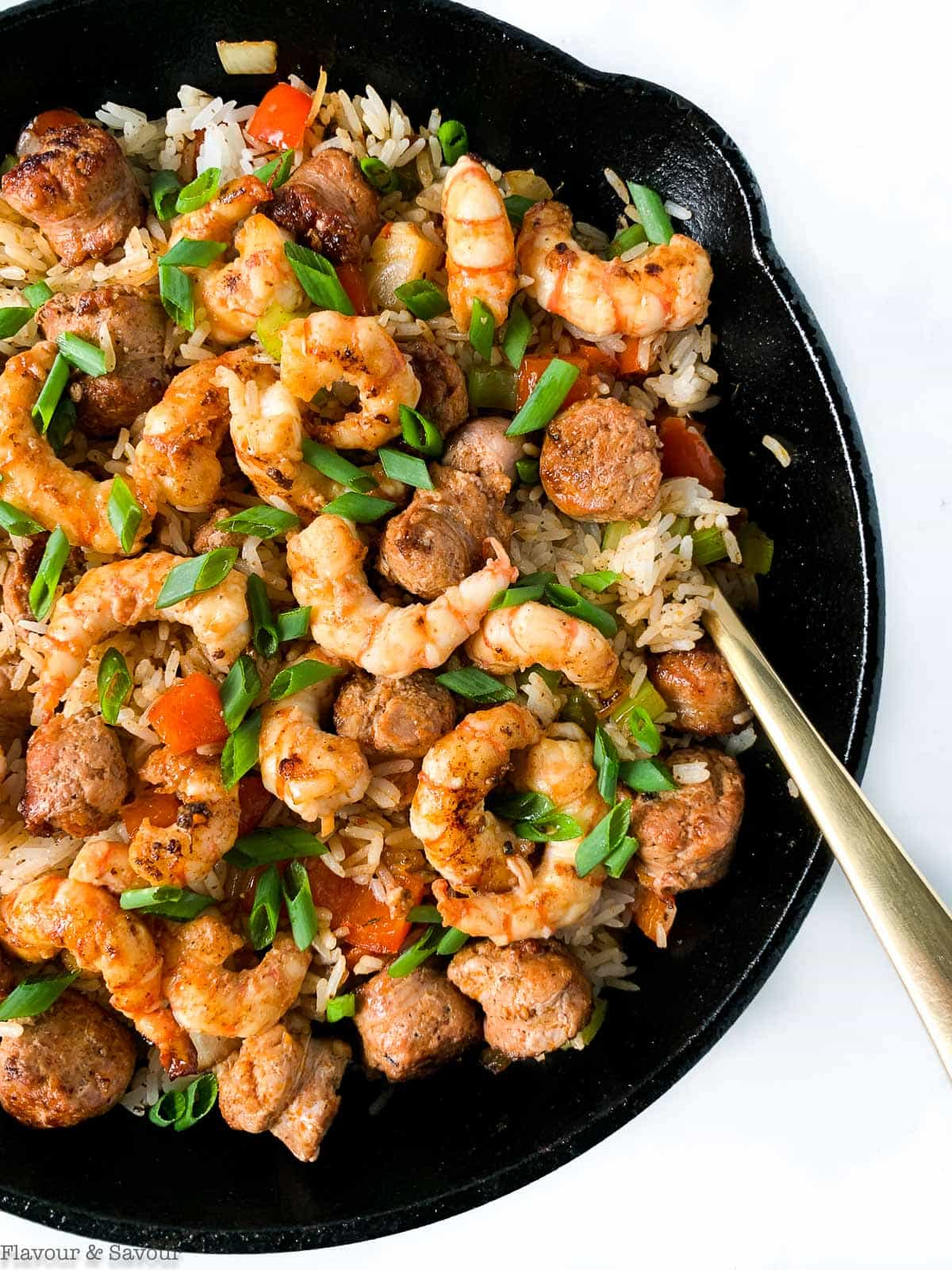 Close up view of a cast iron skillet with Cajun Shrimp Fried Rice