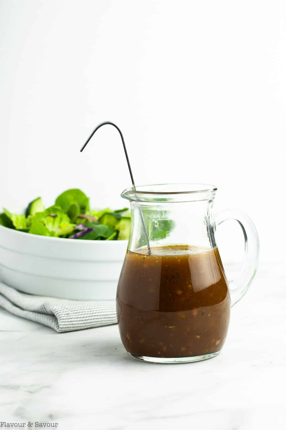 Easy Maple Balsamic Dressing in a small glass pitcher