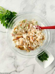 Folding crab meat into dip ingredients.
