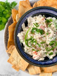 Close up overhead view of cold crab dip surrounded by crackers