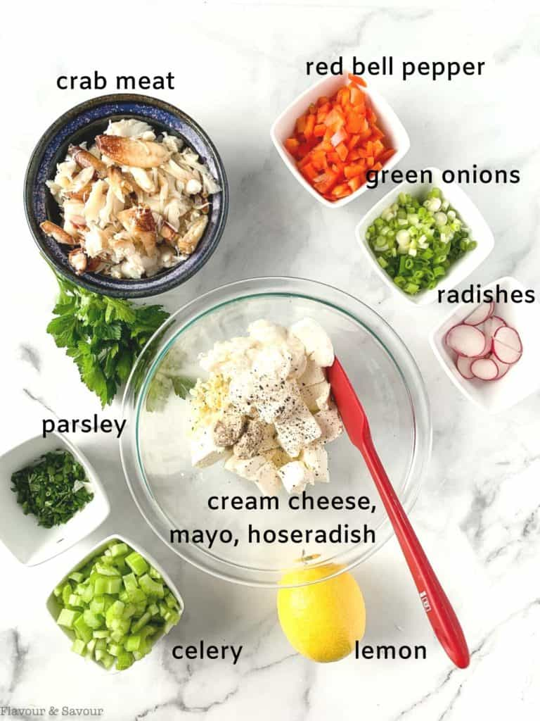 Overhead view of ingredients with labels for cold crab meat dip
